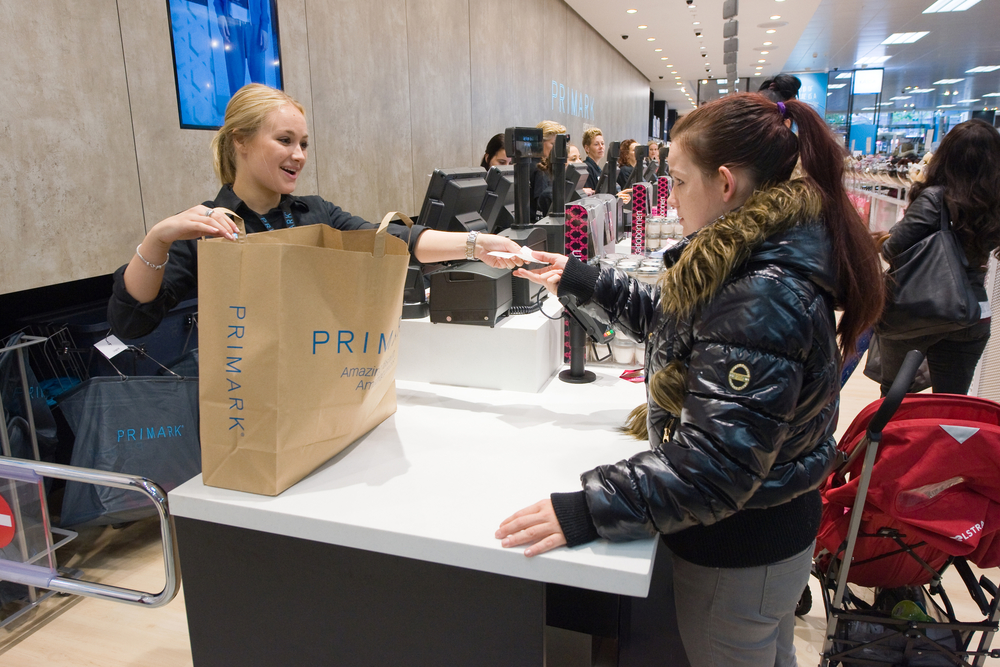 ENSCHEDE, NETHERLANDS - AUG 19, 2014: People are shopping in a new branch of warehouse Primark on the first day at the opening, August 19, 2014 in the Netherlands