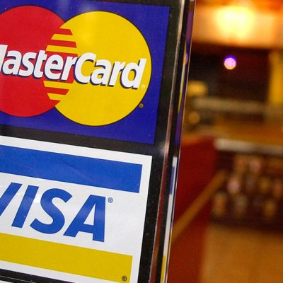 Visa, MasterCard and a number of US banks will pay retailers $6.2 billion